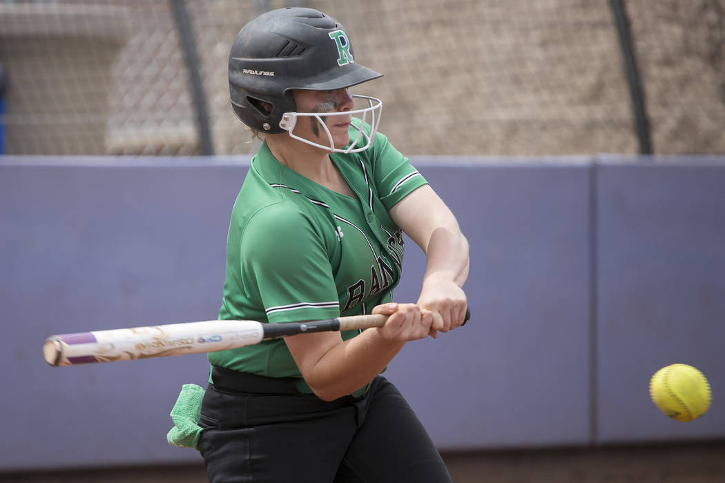 Rancho freshman MacKenzie Perry (20) hits the ball against Palo Verde during a game in the Class 4A state softball tournament at Bishop Gorman High School on Thursday, May 18, 2017, in Las Vegas.  ...