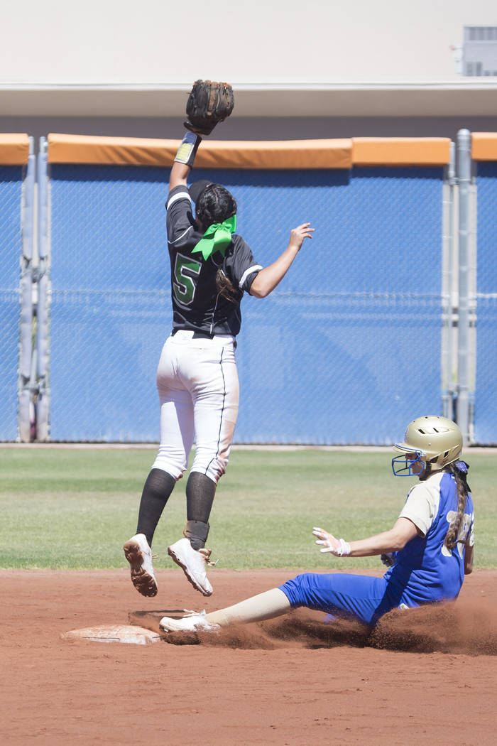 Palo Verde junior Lauryn Barker, left, jumps for the ball as Reed senior Allie Hughes slides into second during a game at Bishop Gorman High School on Friday, May 19, 2017, in Las Vegas. Palo Verd ...