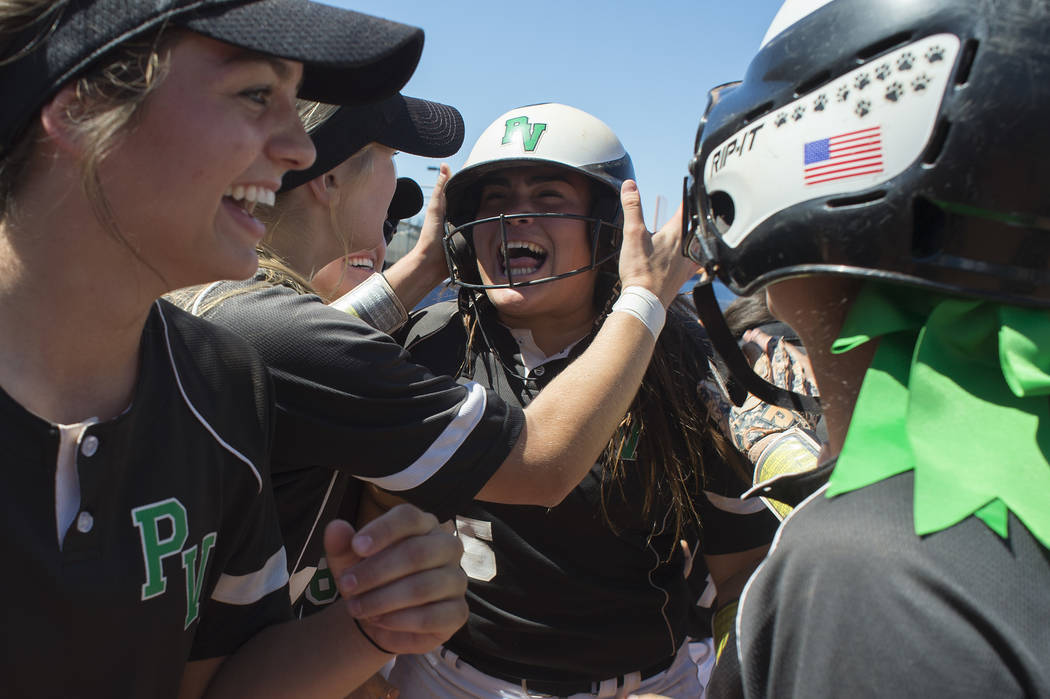 Palo Verde junior Grace Chavez, center, celebrates with her team after she hit a home run during a game against Reed at Bishop Gorman High School on Friday, May 19, 2017, in Las Vegas. Palo Verde  ...
