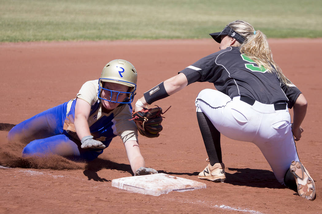 Palo Verde junior Lauryn Barker tags Reed senior Jessica Sellers out on third base during a game at Bishop Gorman High School on Friday, May 19, 2017, in Las Vegas. Palo Verde won 2-0 and will adv ...