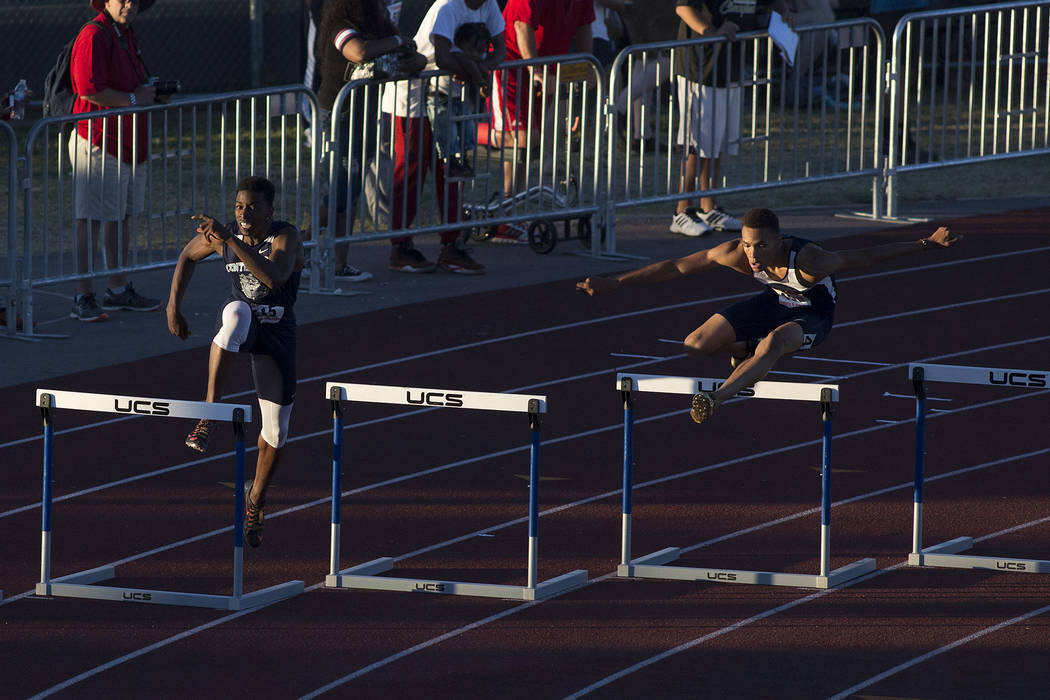 Centennial senior Savon Scarver, left, and Legacy senior Jamaal Britt, right, participate in the 300-meter hurdles at the NIAA State Track & Field Championships at Foothill High School on Frid ...