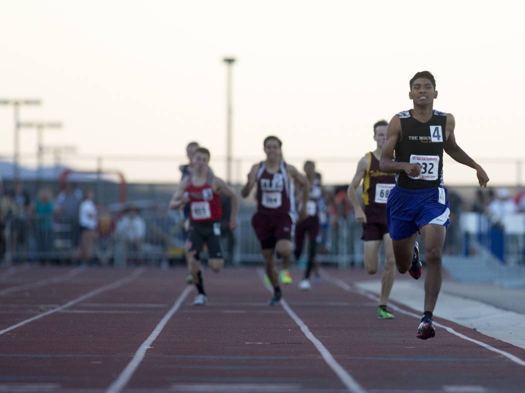 Sunrise Mountain senior Musio Jimenez-Vazquez takes takes the lead in the 3A boys 800-meter dash at the NIAA State Track & Field Championships at Foothill High School on Friday, May 19, 2017 i ...