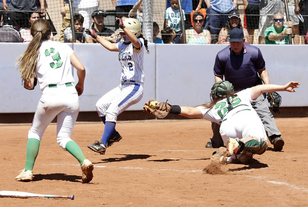 Palo Verde's Grace Chavez, right, is unable to tag Reed's Alyssa Hernandez during their Class 4A State Championship softball game in Las Vegas on Saturday, May 20, 2017. Bizuayehu Tesfaye Las Vega ...