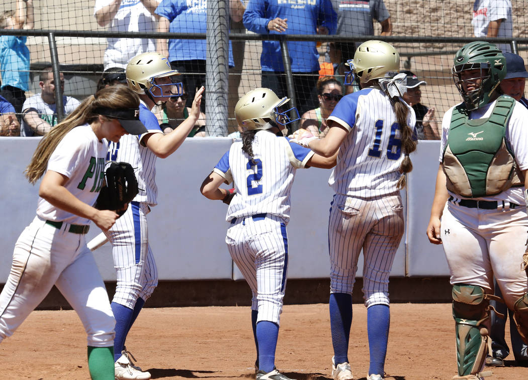 Reed's Alyssa Hernandez (2) celebrates with her teammates after scoring against Palo Verde during their Class 4A State Championship softball game in Las Vegas on Saturday, May 20, 2017. Bizuayehu  ...