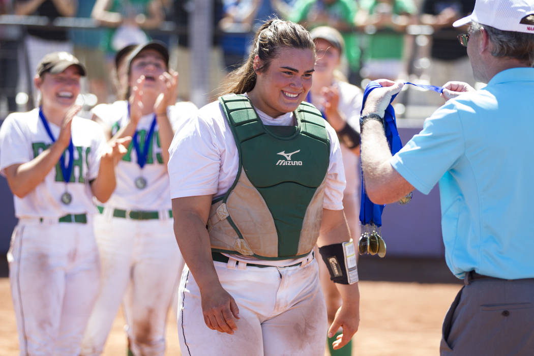 Palo Verde's Grace Chavez (25) receives a medal following her team's win against Reed in the Nevada Class 4A state softball final on Saturday, May 20, 2017 in Las Vegas. Palo Verde won 9-3. Erik V ...