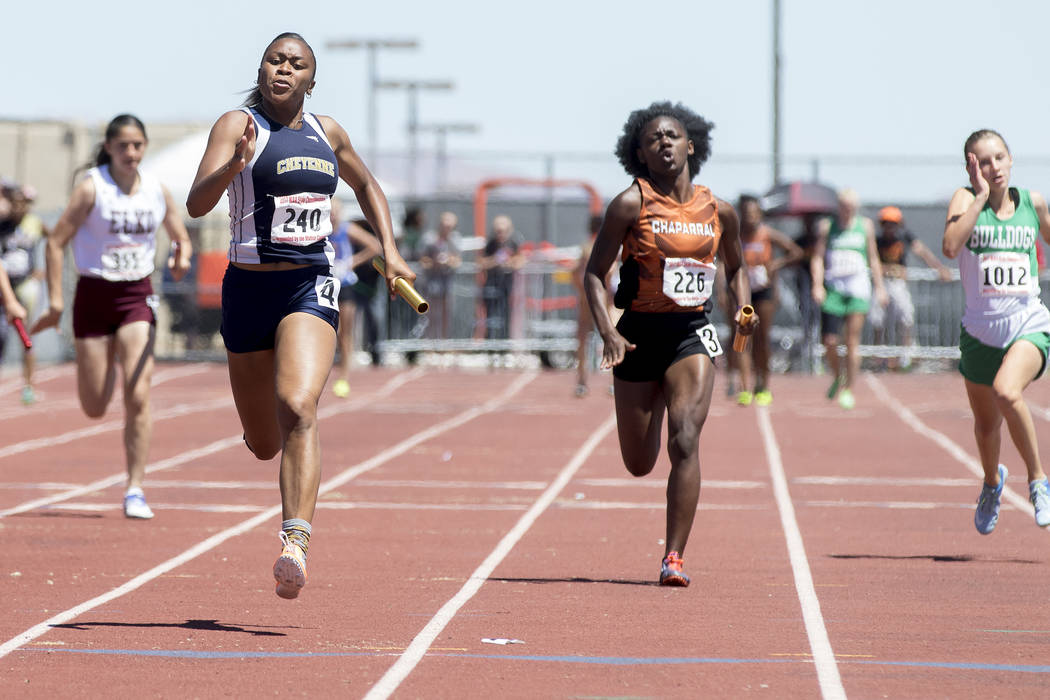 Cheyenne senior Angela Hammond finishes the last leg of the girls 4x100-meter relay during the NIAA 3A State Track & Field Championships at Foothill High School on Saturday, May 20, 2017 in He ...