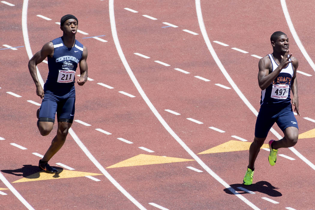 Centennial junior Randall Jubilee catches up to Legacy junior Jeriel Thomas in the boys 400-meter dash during the NIAA 4A State Track & Field Championships at Foothill High School on Saturday, ...