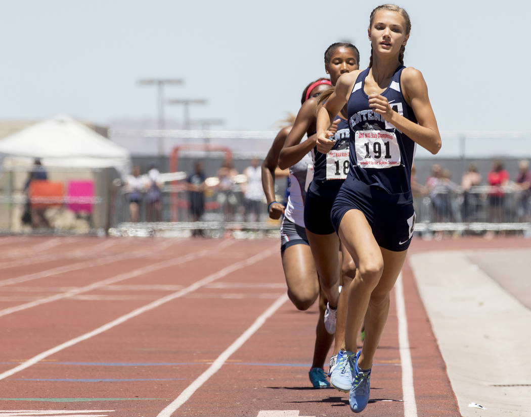 Centennial senior Karina Haymore leads the pack during the girls 800-meeter run during the NIAA State Track & Field Championships at Foothill High School on Saturday, May 20, 2017 in Henderson ...