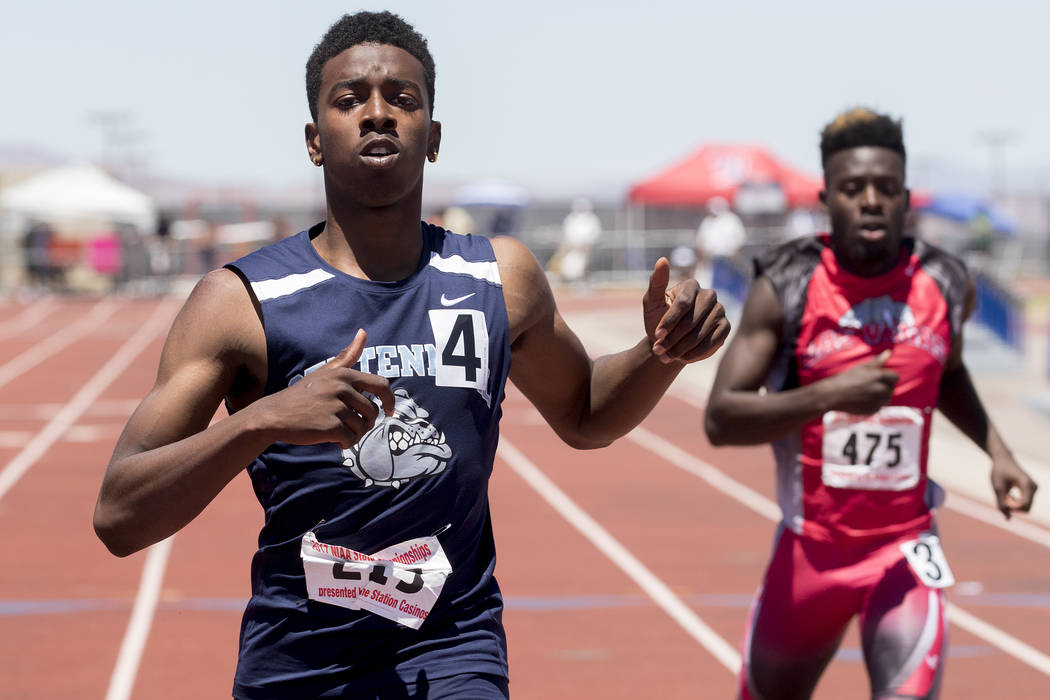 Centennial senior Savon Scarver finishes in first with a time of 21.51 in the boys 200-meter dash during the NIAA State Track & Field Championships at Foothill High School on Saturday, May 20, ...