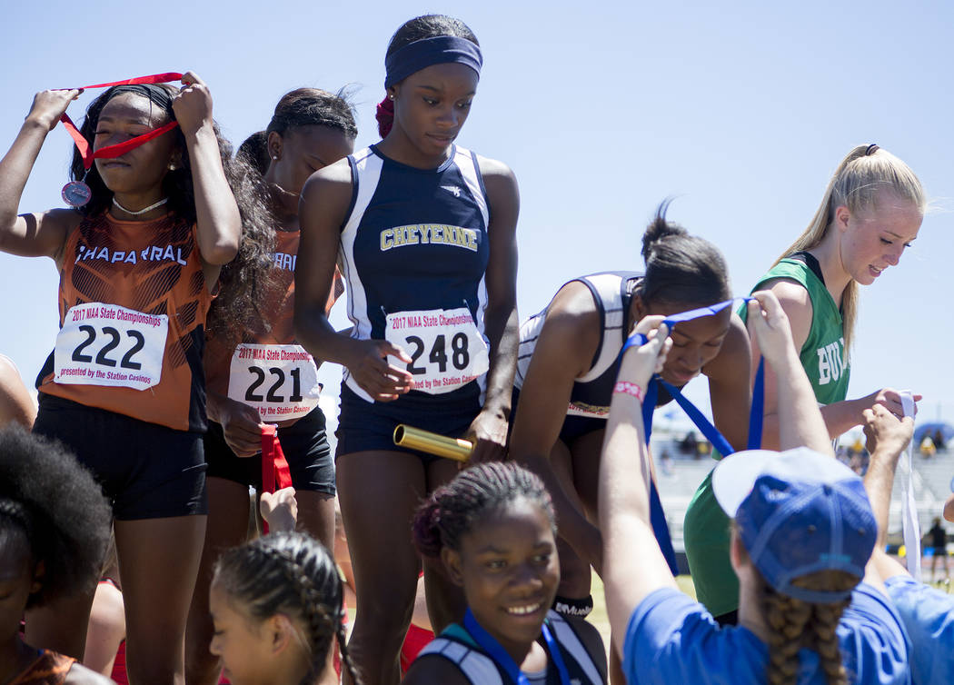Cheyenne runners receive their medals in the girls 4x100-meter relay during the NIAA 3A State Track & Field Championships at Foothill High School on Saturday, May 20, 2017 in Henderson. Cheyen ...