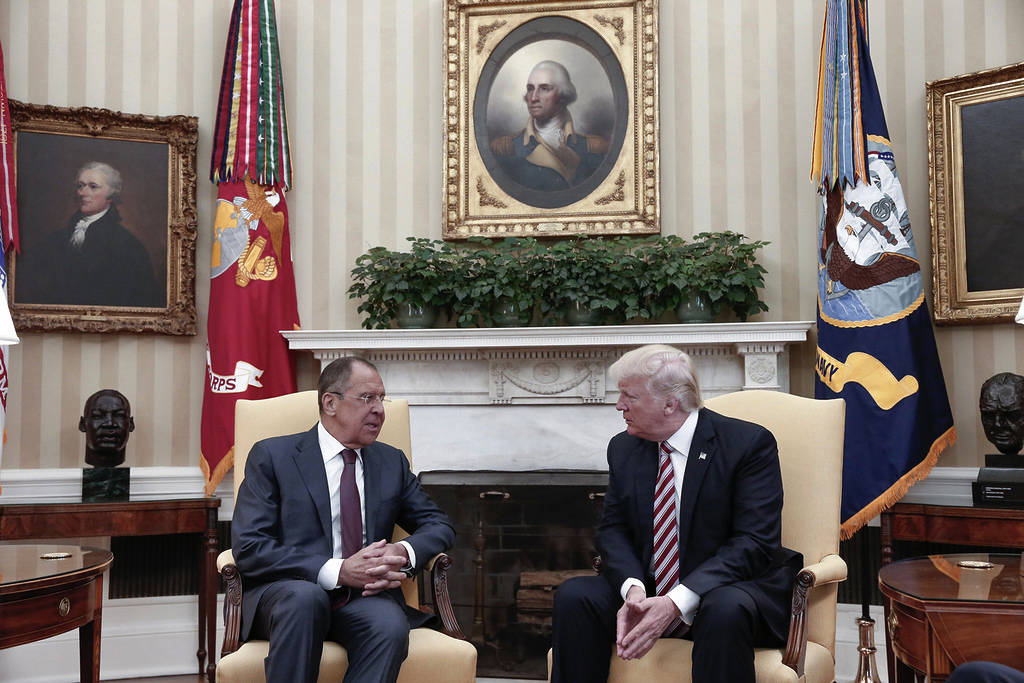 President Donald Trump, right, meets Russian Foreign Minister Sergey Lavrov at the White House in Washington, Wednesday, May 10, 2017.  (Russian Foreign Ministry Photo via AP)