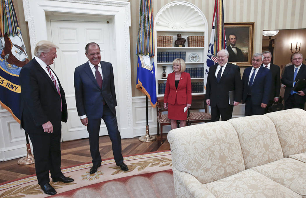 U.S. President Donald Trump meets with Russian Foreign Minister Sergey Lavrov, second left, at the White House in Washington, Wednesday, May 10, 2017. (Russian Foreign Ministry Photo via AP)