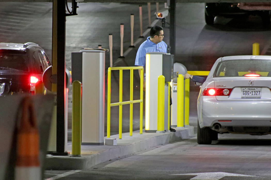 An employee watches a customer pay for parking near the parking garage exit at the Cosmopolitan Las Vegas, Tuesday, May 16, 2017. Gabriella Benavidez Las Vegas Review-Journal @latina_ish