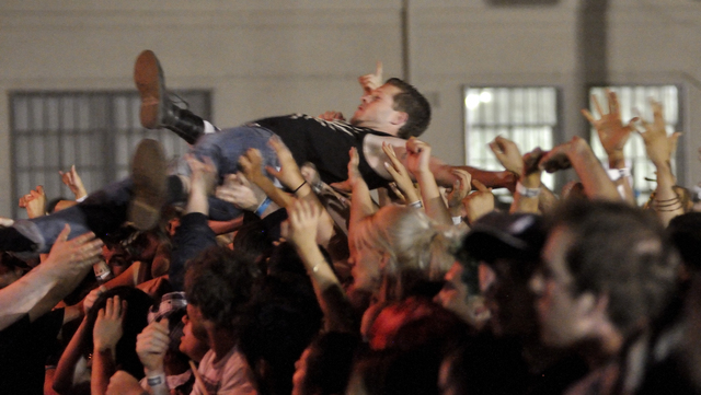 A crowd surfer is hoisted above the throng at the Outdoor Stage at the corner of East Stewart Avenue and North Las Vegas Boulevard at The Adicts show during Punk Rock Bowling weekend on Saturday,  ...