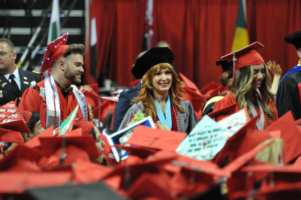 Janet King, 54, who has stage 3 lung cancer, walks to the stage May 13, 2017, at the Thomas & Mack Center to receive her doctorate at UNLV's spring commencement ceremony. (Jeff Mosier/View)