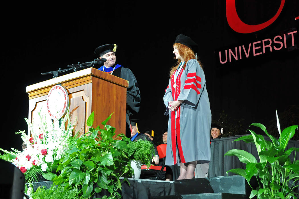 UNLV President Len Jessup looks at Janet King on May 13, 2017, as he talks about King's battle with cancer at UNLV's spring commencement ceremony at the Thomas & Mack Center. (Jeff Mosier/View)