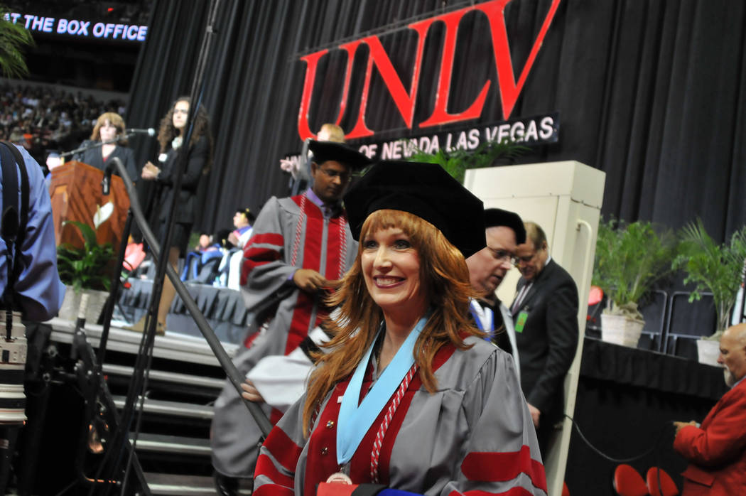 Janet King, 54, exits the stage May 13, 2017, at UNLV's spring commencement ceremony at the Thomas & Mack Center. (Jeff Mosier/View)
