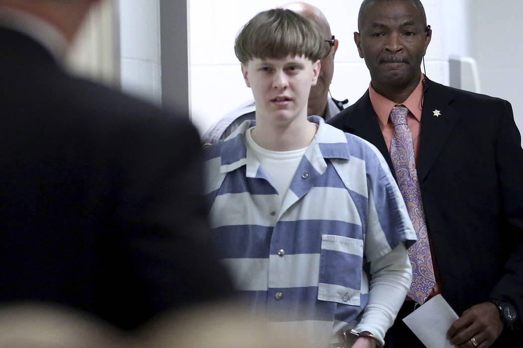 Dylann Roof enters the court room at the Charleston County Judicial Center to enter his guilty plea on murder charges in Charleston, S.C. on Monday, April 10, 2017. (Grace Beahm/The Post And Couri ...