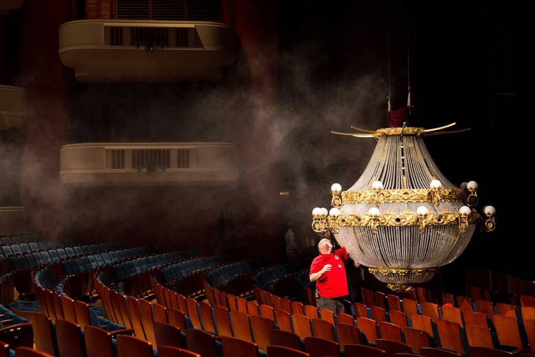 "A crew member works on a pivotal ""Phantom of the Opera"" prop: the falling chandelier. Smith Center for the Performing Arts"