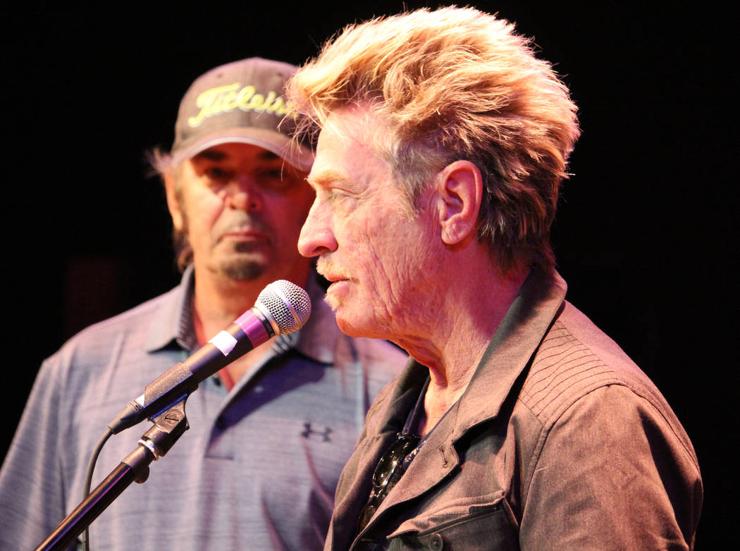 Ross Valory, from the band Journey, speak to students at Las Vegas Academy of the Arts in Las Vegas, Wednesday, May 17 2017, as another band member Jonathan Cain looks on. Gabriella Benavidez Las  ...