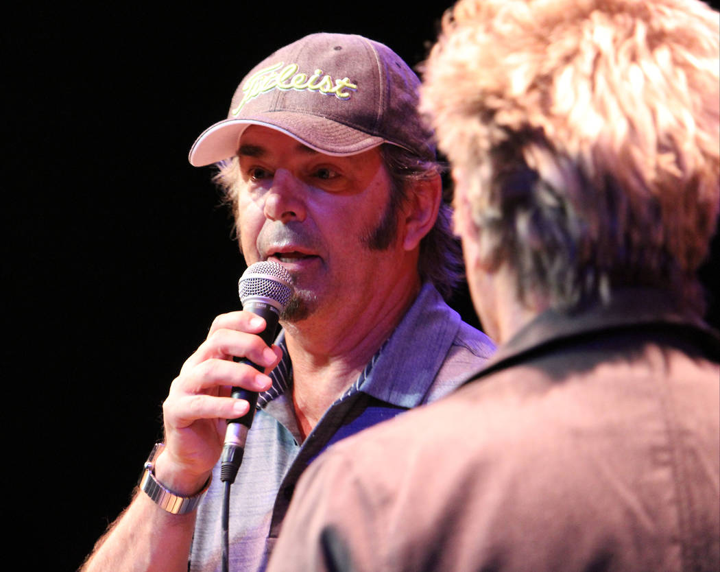 Jonathan Cain, left, from the band Journey, tells the story on how he became a member of the band to students at Las Vegas Academy of the Arts, Wednesday, May 17 2017. Gabriella Benavidez Las Vega ...