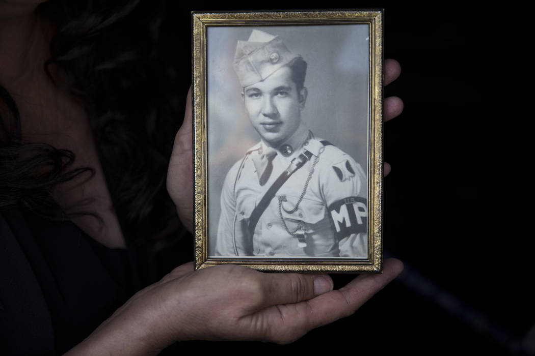 Isabella McGuff shows a picture of her great uncle Korean War soldier Pfc. Manuel M. Quintana before his dignified transfer at McCarran International Airport on Wednesday, May 17, 2017 in Las Vega ...