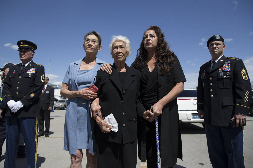 Korean War soldier Pfc. Manuel M. Quintana's niece Isabel Malloy, from left, sister Mary Moreno, and great niece Isabella McGuff show their emotions as members of  the Nevada National Guard honor  ...