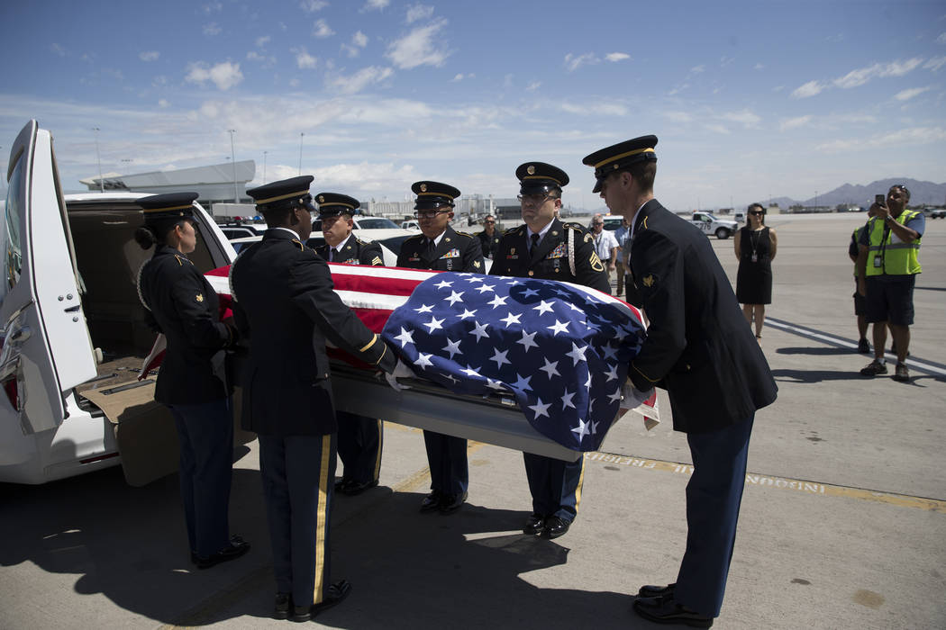 Members of the Nevada National Guard honor guard conduct the dignified transfer of remains of Korean War soldier Pfc. Manuel M. Quintana from a flight that arrived at McCarran International Airpor ...