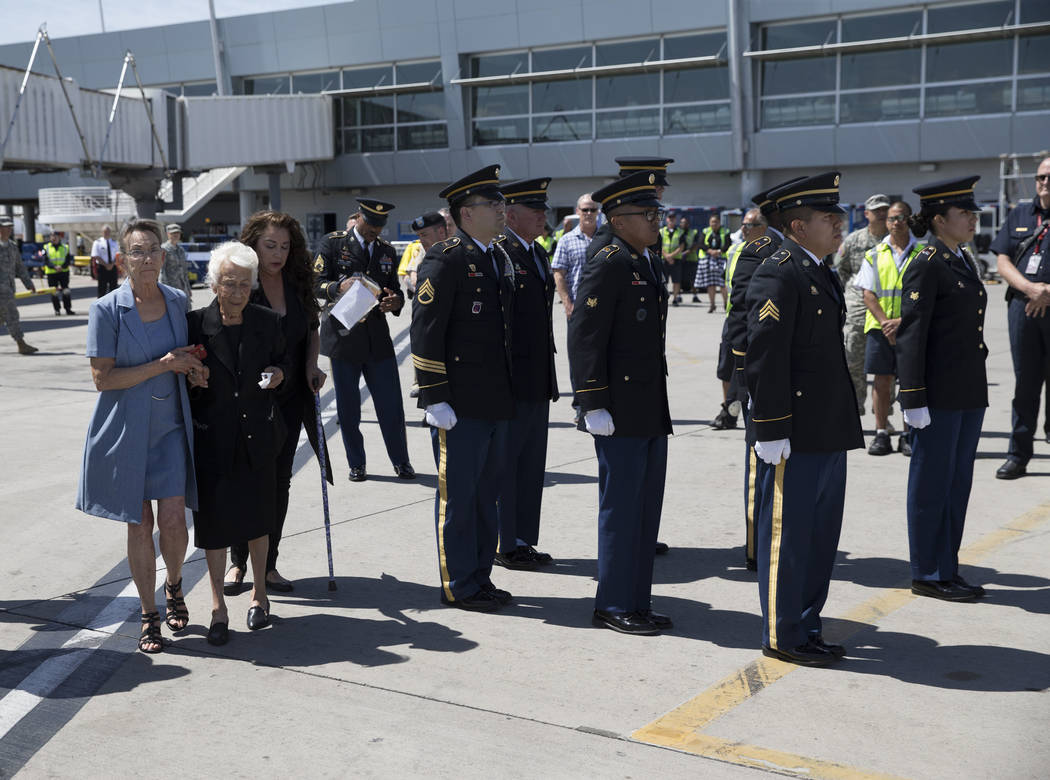 Korean War soldier Pfc. Manuel M. Quintana's niece Isabel Malloy, from left, sister Mary Moreno, and great niece Isabella McGuff attend the dignified transfer of Quintana at McCarran International ...
