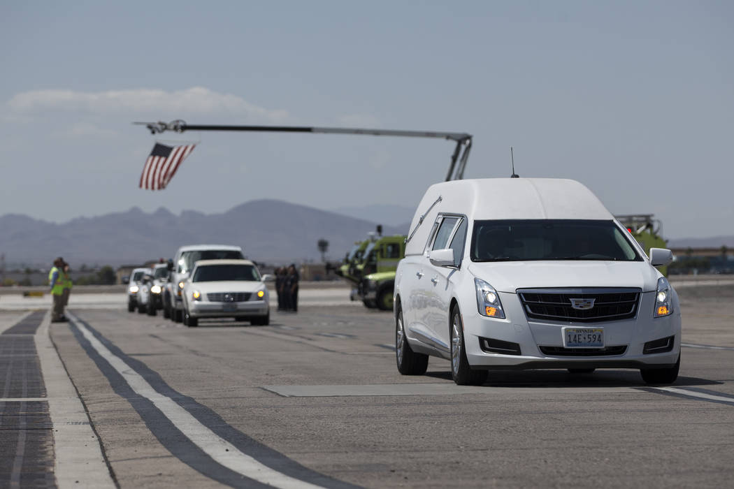The procession following the dignified transfer of Korean War soldier Pfc. Manuel M. Quintana by the Nevada National Guard honor guard at McCarran International Airport on Wednesday, May 17, 2017  ...