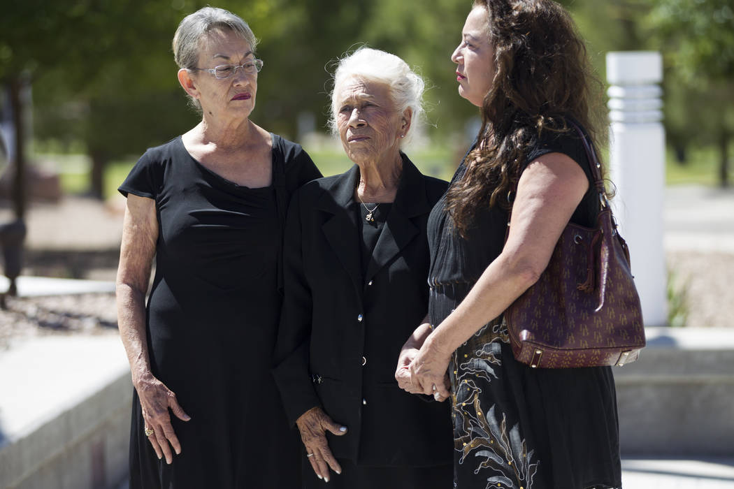 Korean War soldier Pfc. Manuel M. Quintana's niece Isabel Malloy, from left, sister Mary Moreno, and great-niece Isabella McGuff during Quintana's funeral at the Southern Nevada Veterans Memorial  ...