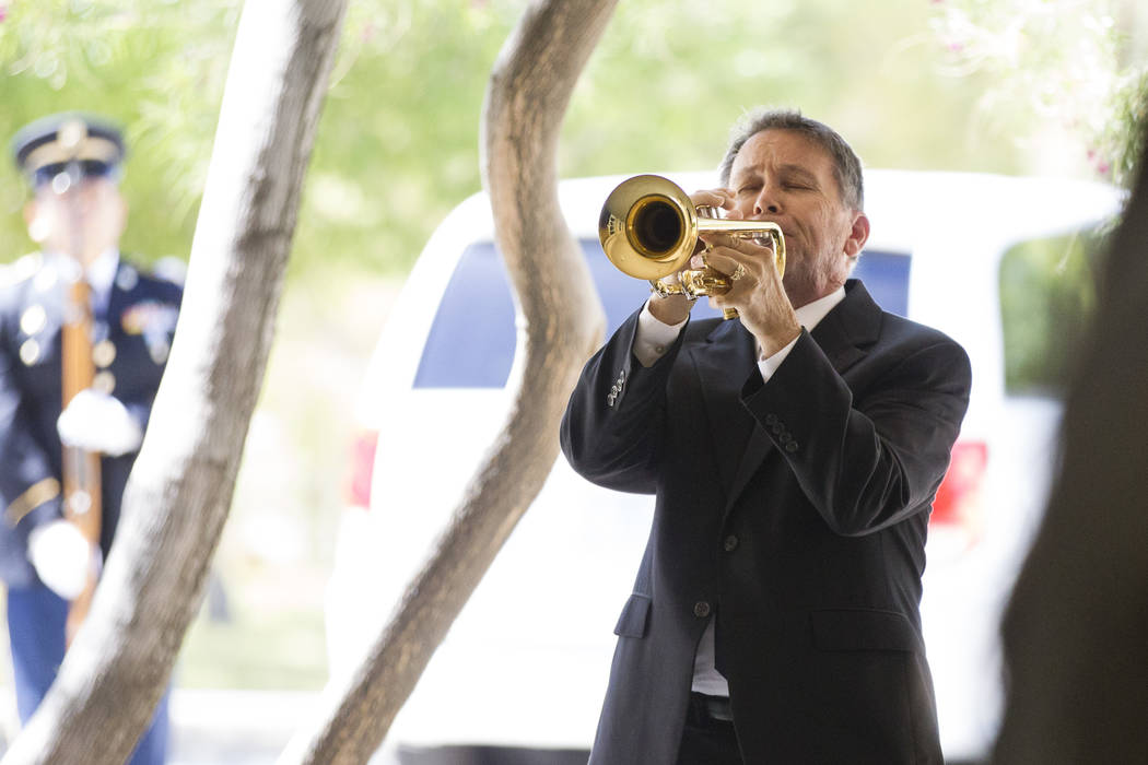 Dan Johnson, member of the Trumpeters Alliance to Perform Patriotic Services, during funeral for Korean War soldier Pfc. Manuel M. Quintana at the Southern Nevada Veterans Memorial Cemetery on Fri ...