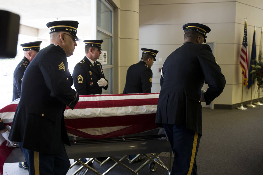 The Nevada Army National Guard Honor Guard moves the flag-draped casket with the remains of Korean War soldier Pfc. Manuel M. Quintana during his funeral at the Southern Nevada Veterans Memorial C ...