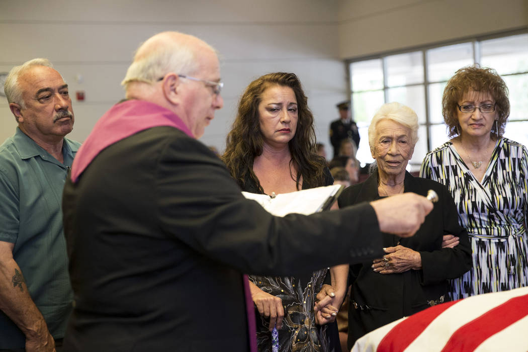 Korean War soldier Pfc. Manuel M. Quintana's nephew David Moreno, from left, great niece Isabella McGuff, sister Mary Moreno, and niece Ginny Bennett during Quintana's funeral at the Southern Neva ...
