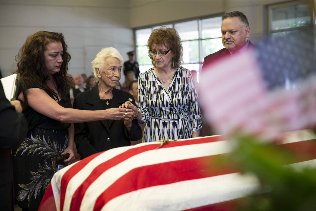Korean War soldier Pfc. Manuel M. Quintana's great niece Isabella McGuff, from left, sister Mary Moreno, niece Ginny Bennett, and nephew Richard Murrieta, during Quintana's funeral at the Southern ...