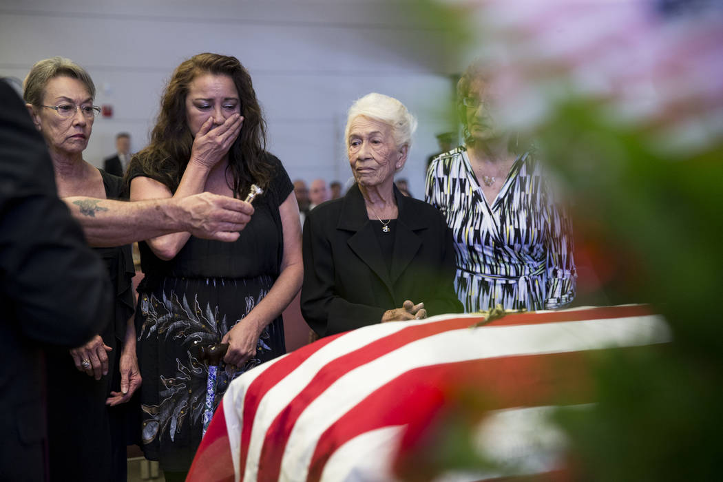 Korean War soldier Pfc. Manuel M. Quintana's niece Isabel Malloy, from left, great niece Isabella McGuff, sister Mary Moreno, and niece Ginny Bennett, during Quintana's funeral at the Southern Nev ...