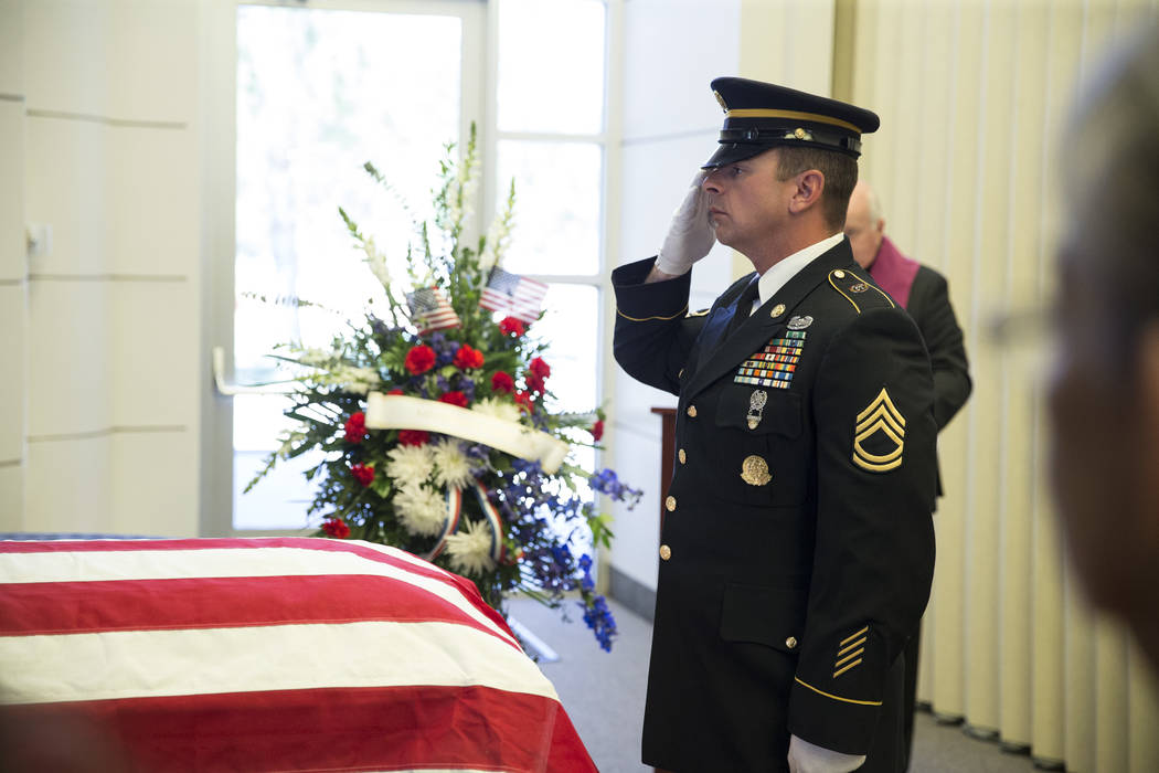 The U.S. Army National Guard Honor Guard member Sfc. Johnson Patrick during the funeral for Korean War soldier Pfc. Manuel M. Quintana at the Southern Nevada Veterans Memorial Cemetery on Friday,  ...