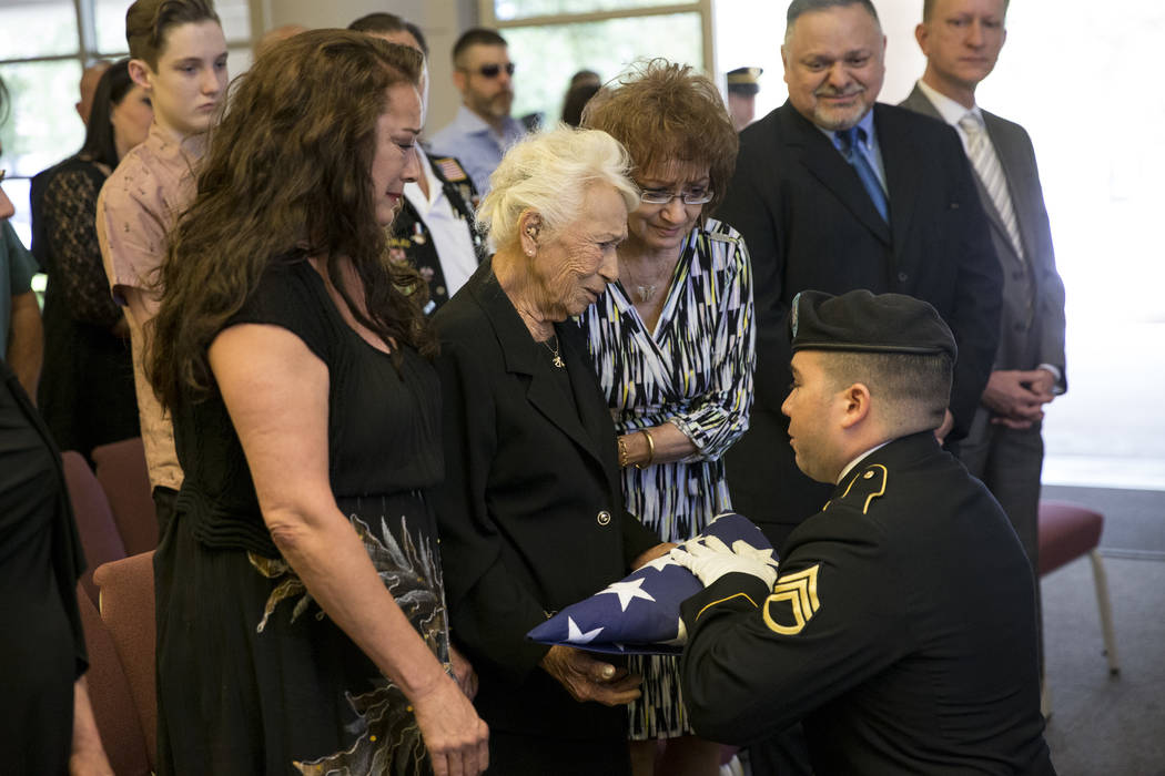 Korean War soldier Pfc. Manuel M. Quintana's great nephew Nevada Army National Guard Staff Sgt. Nicholas Mapes presents the American flag to his great grandmother Mary Moreno during Quintana's fun ...