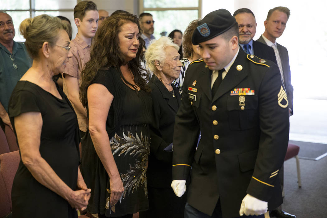 Korean War soldier Pfc. Manuel M. Quintana's great nephew U.S. Army National Guard Ssg. Nicholas Mapes after presenting the American flag to his great grandmother Mary Moreno, third from left, dur ...