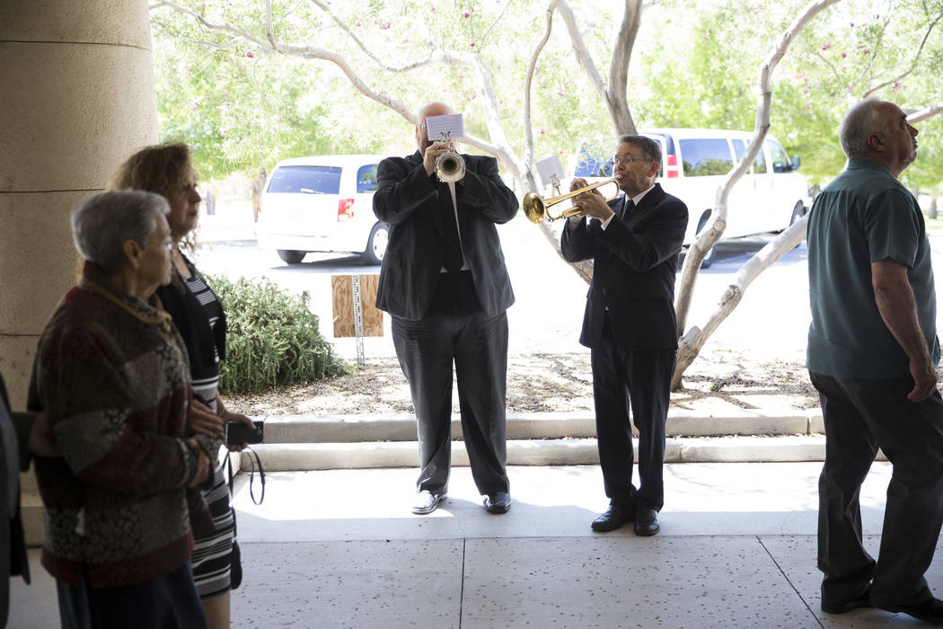 Gary Cordell, left, and Dan Johnson, members of the Trumpeters Alliance to Perform Patriotic Services, during funeral for Korean War soldier Pfc. Manuel M. Quintana at the Southern Nevada Veterans ...