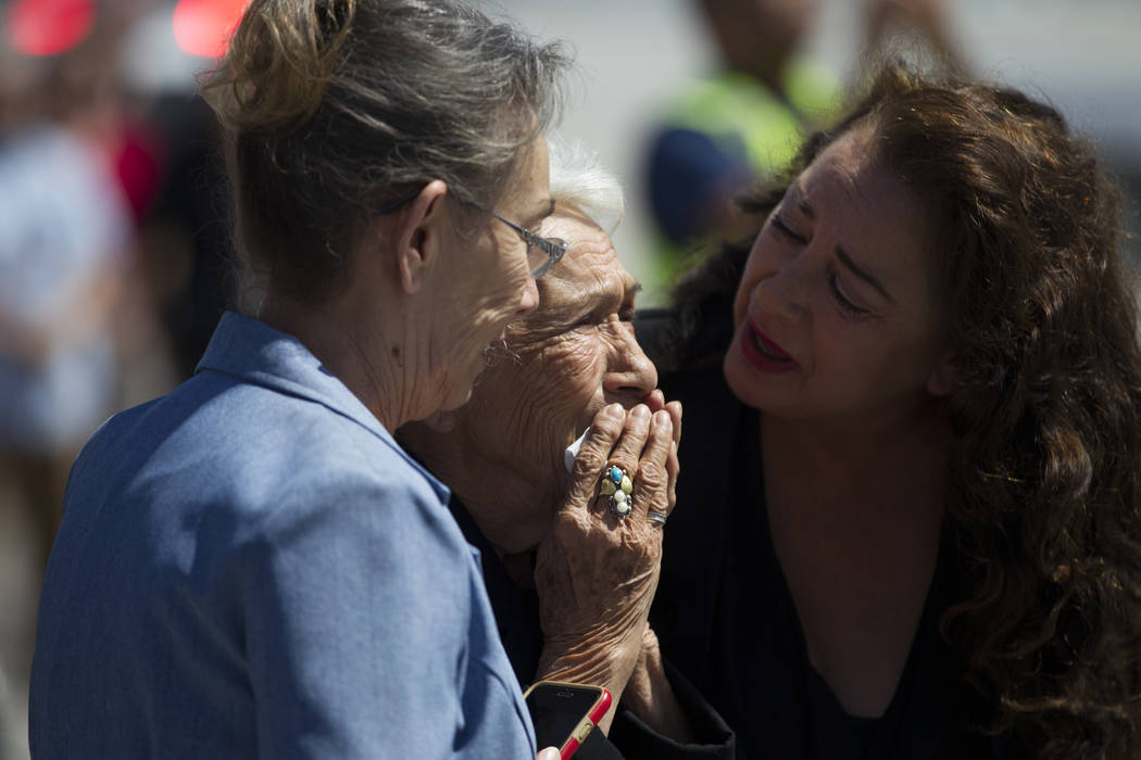 Korean War soldier Pfc. Manuel M. Quintana's niece Isabel Malloy, from left, sister Mary Moreno, and great-niece Isabella McGuff show their emotions as members of  the Nevada National Guard honor  ...