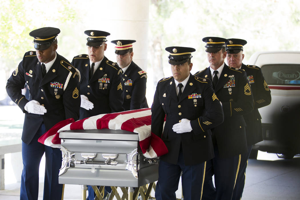 The Nevada National Guard Honor Guard moves the flag-draped casket with the remains of Korean War soldier Pfc. Manuel M. Quintana during his funeral at the Southern Nevada Veterans Memorial Cemete ...