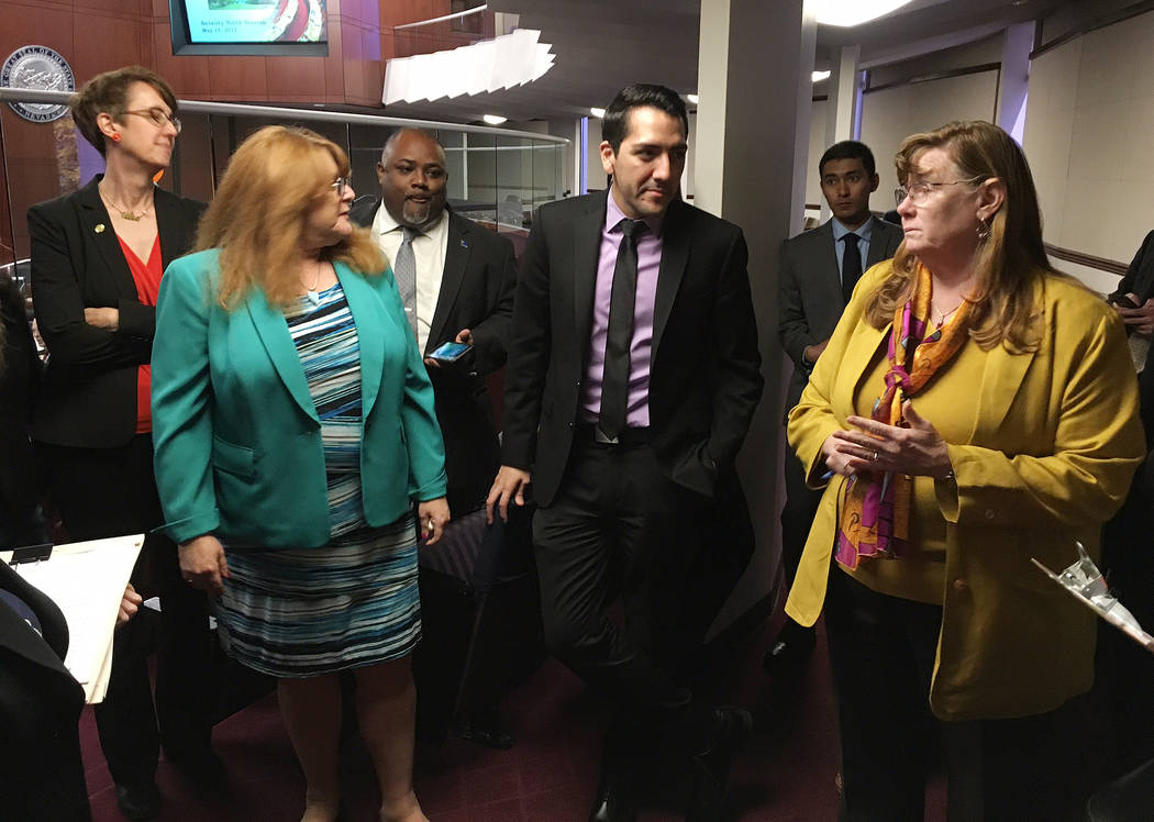 Members of the Assembly Ways and Means Committee, including Chairwoman Maggie Carlton, right, vote Monday, May 15, 2017, to introduce a bill to provide funding for legal counsel for the Gaming Con ...