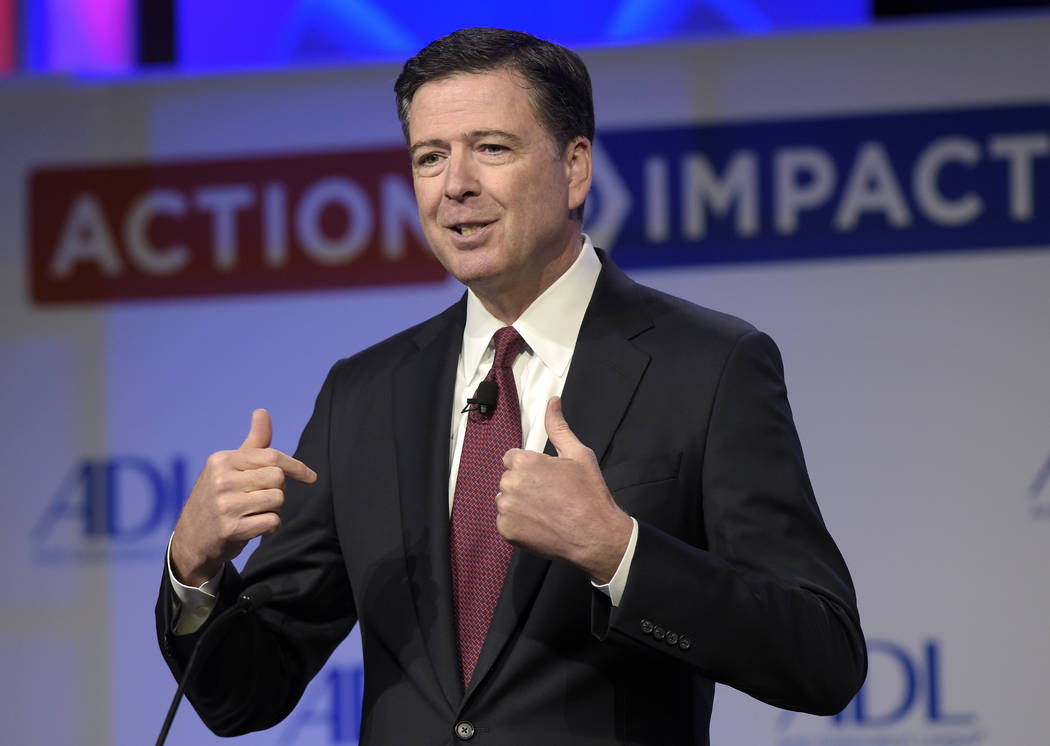 FILE - In this May 8, 2017, file photo, then-FBI Director James Comey speaks to the Anti-Defamation League National Leadership Summit in Washington. The White House is disputing a report that Pres ...