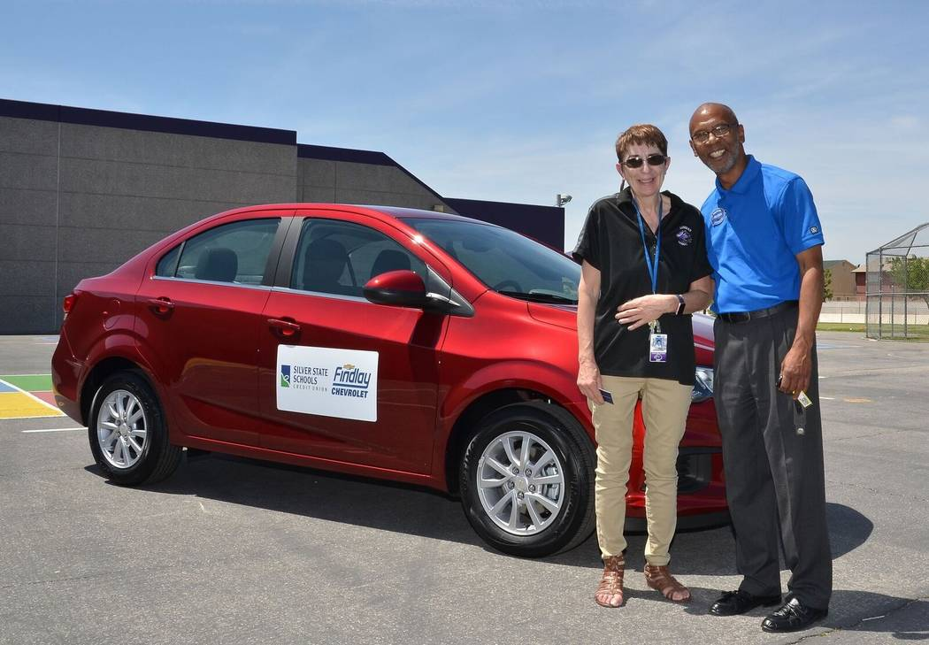 Findlay Chevy Loman Elementary third-grade teacher Claudia Rosenberger is given the keys to a 2017 Chevrolet Sonic LT by Findlay Chevrolet community liaison Reuben Banks, capping the Clark County  ...