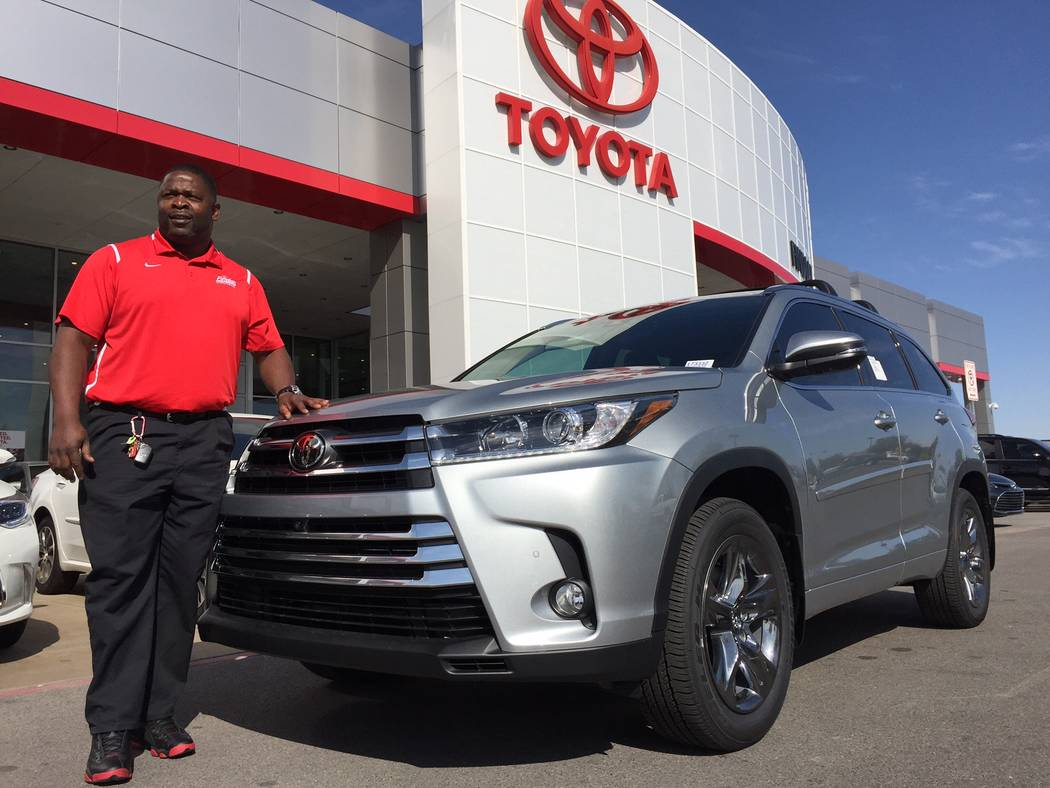 Findlay Toyota Findlay Toyota sales certified sales consultant Antwaun Bynum is seen with a 2017 Toyota Highlander sport utility vehicle at the dealership situated at 7733 Eastgate Road in the Val ...