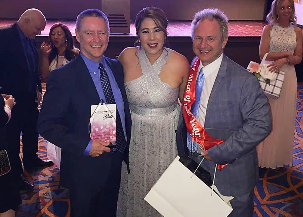 Findlay Campaign manager Stephanie Bernas is flanked by Findlay Automotive Group CFO Tyler Corder, left, and John Barr at the annual Leukemia and Lymphoma Society's gala recently at the JW Marri ...