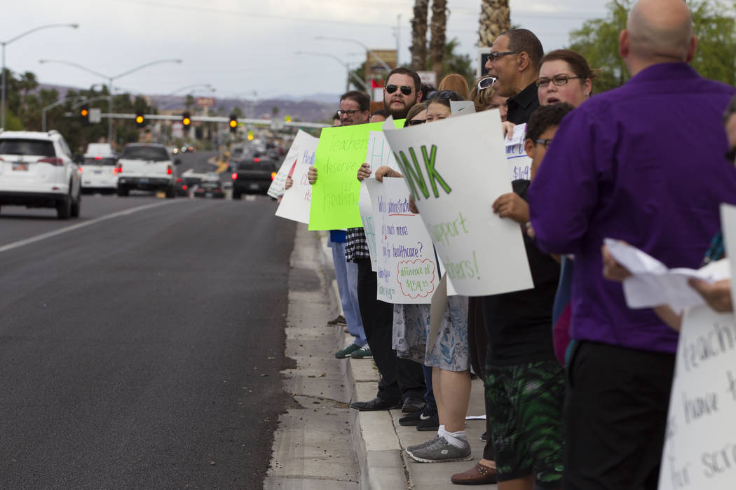 Teachers and supporters rally for affordable health insurance outside of the Clark County School District Education Center before a board meeting on Wednesday, May 17, 2017 in Las Vegas. Erik Verd ...