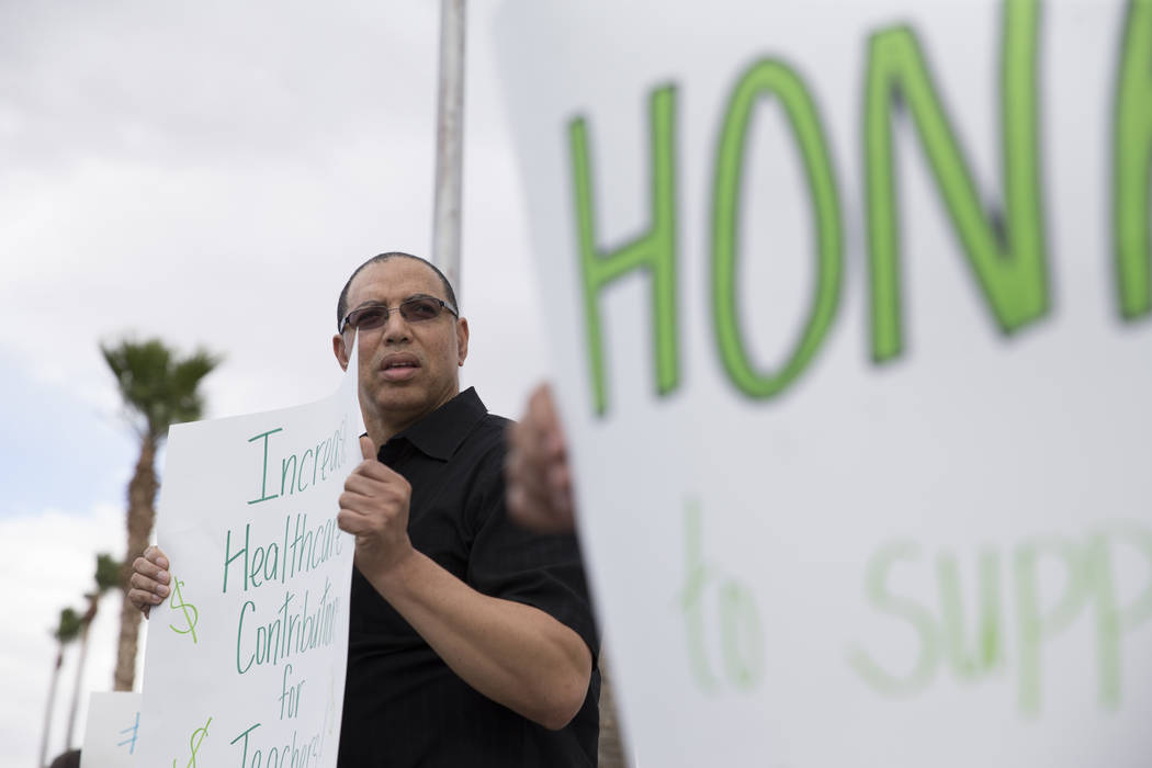 Middle school teacher Karl Byrd attends a rally for affordable health insurance with other teachers and supporters outside of the Clark County School District Education Center before a board meeti ...