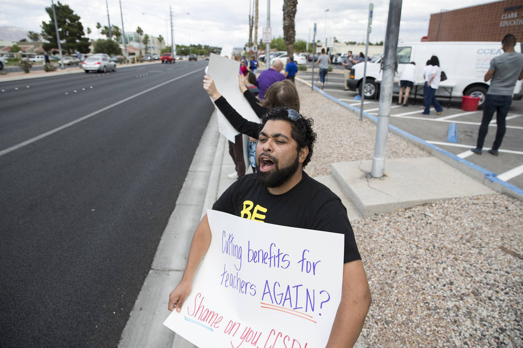 Middle school teacher Mario Wolthers attends a rally for affordable health insurance with other teachers and supporters outside of the Clark County School District Education Center before a board  ...